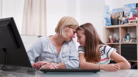 role model : Mother and daughter showing affection to each other. Portrait of a young female and a teenage girl showing love to each other. Stock Footage