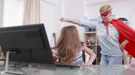 role model : Supermom comes to help her daughter while she is having a problem. Girl gets help from a woman dressed in superhero costume.