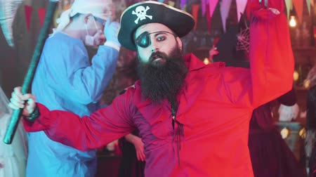 brincos : Handsome young man with big beard dressed as a pirate at a halloween party