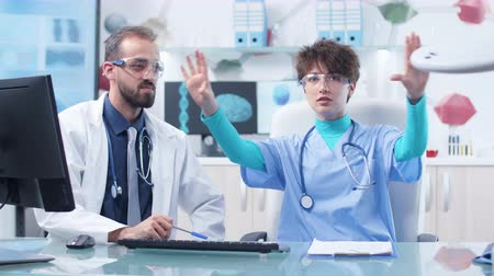 surgical light : Doctor and nurse wearing augmented reality glasses Stock Footage