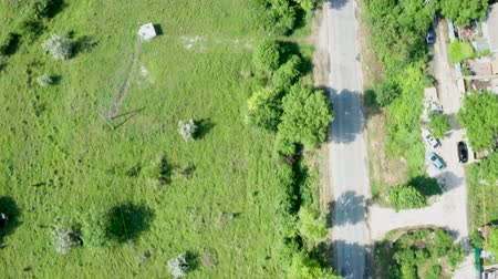 varoşlarda : Top down view of a road in rural area. Aerial drone footage Stok Video