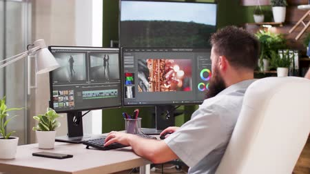 creator : In post production house two editors are talking about new clip Stock Footage
