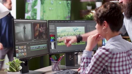 creator : Freelancer working with an editor on some footage in professional editing and coloring applications