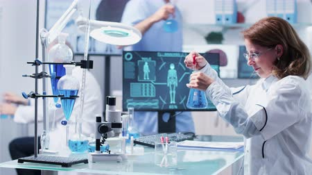 farmacologia : In modern high end laboratory a team is having a busy day