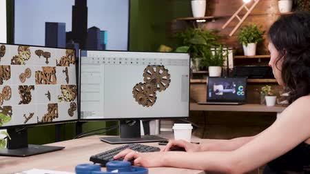 rack focus : Female designer works on new gear prototypes in professional 3D software application. Rack focus, slow motion shot