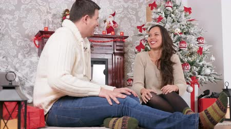 Beautiful caucasian couple giving presents to each other on the Christmas eve. Happy family, love and Xmas surprise Wideo