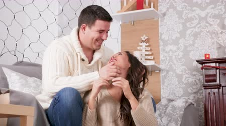 Close up of inlove couple in Christmas decorated room having fun Wideo