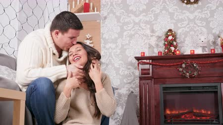 Man covers woman eyes to surprise her in Christmas eve. Beautiful ornated and decorated house