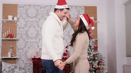 Lovely couple dancing and having fun in Christmas eve