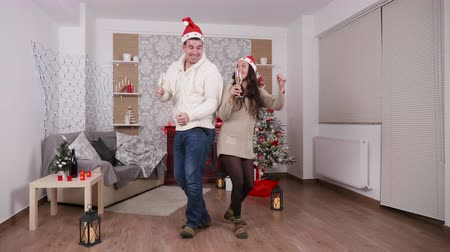 fulllength : Beautiful couple drinking champagne and dancing in Christmas eve