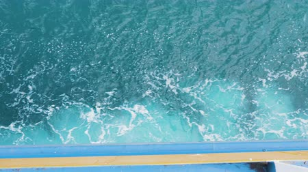 deep sea exploration : Close up footage of waves at side of the ferry. Ferry crusing in deep waters.