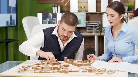 architecture and urbanism : Team of architect working the urbanism of a modern town. Building models.
