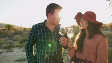 grape basket : Couple tasting wine on a pontoon in warm sunset sunligh, slow motion footage