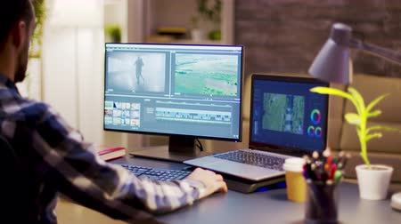 creator : Film maker using modern software for post production in home office. Content creator working on multimedia project. Stock Footage