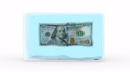 финансы : Dollar Frozen in a Block of Ice. White background, created in 4K, 3d animation Стоковые видеозаписи