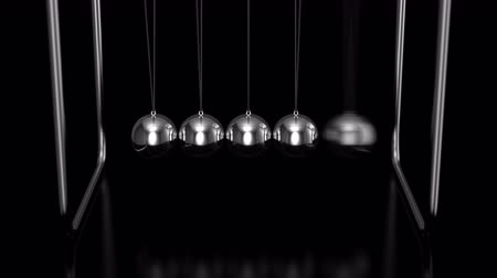 Newtons Cradle Animation. Black background, 2 in 1, loop, alpha matte, created in 4K, 3d animation Stok Video