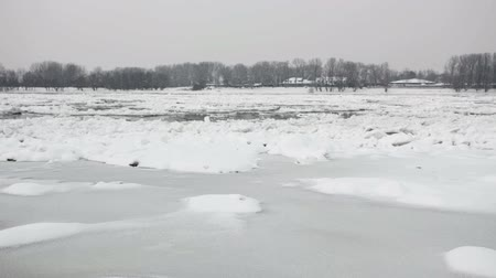 úszó jéghegy : Frozen river Danube at winter - ice floating over river surface