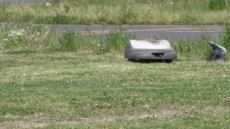 self made : Robotic lawn mower Stock Footage