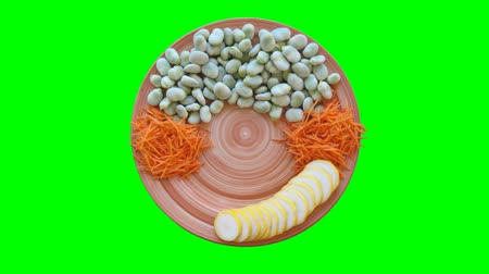 горох : Vegetables appears on a Plate stop motion animation on green screen. Chroma key