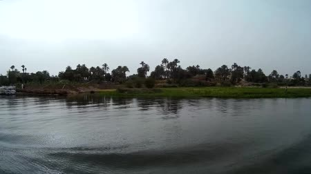 aswan : View of the banks of the Nile Luxor houses
