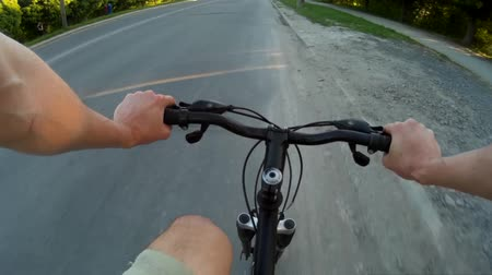 POV Road cyclist on asphalt road at sunset 2
