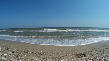 sea waves in shallow water onto black sea beach