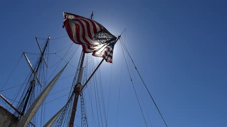 чайка : American flag on a sailing frigate. San Diego.