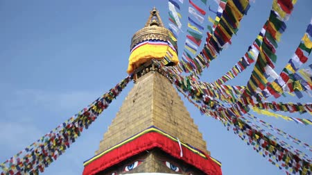 boudha : Colored flags fly near Boudha Bouddhanath or Baudhanath stupa in Nepal