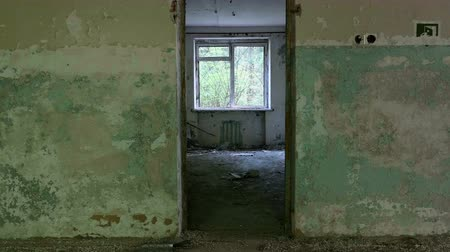 темно : Window and doorway in the neglected house. Smooth and slow dolly shot