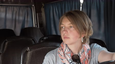 přezka : Young woman setas in the bus