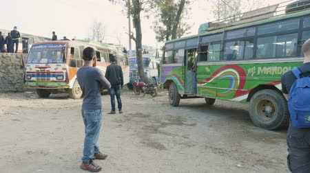 minibus : KATHMANDU, NEPAL - MARCH, 2018: Bus leaves bus staion and goes to Pokhara, march, 2018.
