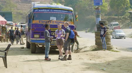 KATHMANDU, NEPAL - MARCH, 2018: Caucasian tourists talk to nepalese guide.