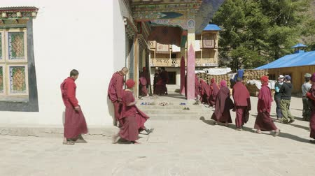 bodhnath : SAMAGAON, NEPAL - MARCH, 2018: Buddhist monks go to service in monastery.