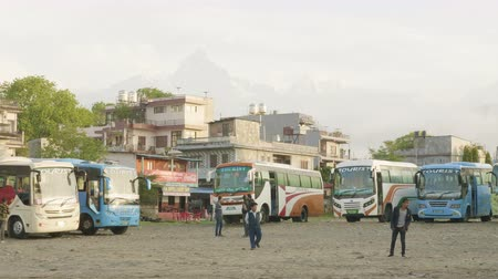 POKHARA, NEPAL - MARCH, 2018: Central bus stop with the tourist buses in big city Pokhara.