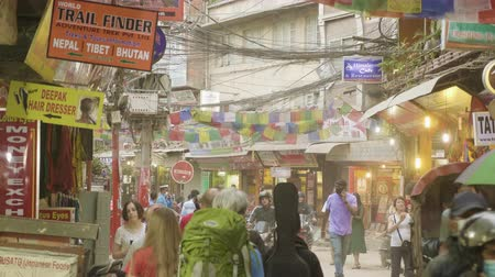 KATHMANDU, NEPAL - MARCH, 2018: Heavy traffic on the streets of the tourist area Thamel in the center of the city. Stock Footage