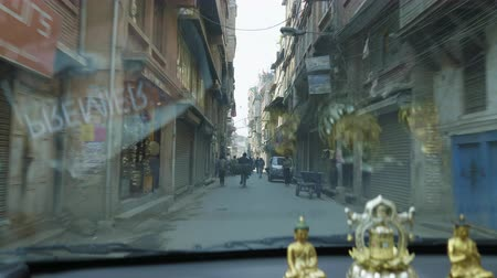 KATHMANDU, NEPAL - MARCH, 2018: View from the car on heavy traffic on the streets of the tourist area Thamel in the center of the city. Stock Footage