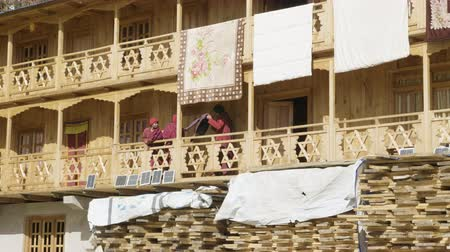 SAMAGAON, NEPAL - MARCH, 2018: Monks communicate on the balcony of their home.