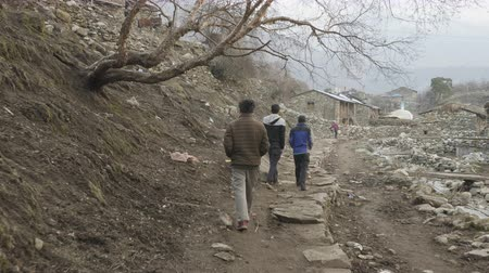 sherpa : SAMAGAON, NEPAL - MARCH, 2018: Local people walks in the village after work day. Stock Footage