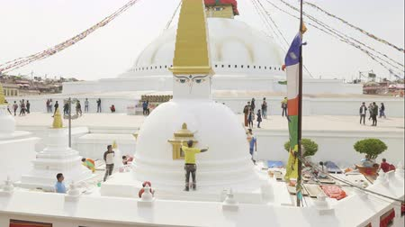 boudha : KATHMANDU, NEPAL - MARCH, 2018: Worker paints Boudhanath Stupa after earthquake in the Kathmandu valley.