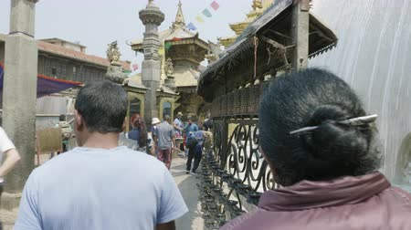 sztúpa : SWAYMBHUNATH, NEPAL - MARCH, 2018: Believers walk around the Swayambhunath Stupa in the Kathmandu valley.