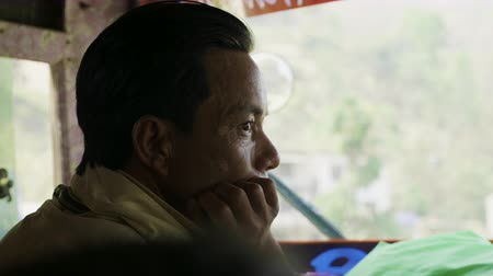 KATHMANDU, NEPAL - MARCH, 2018: Bus driver looks out the window in bus.