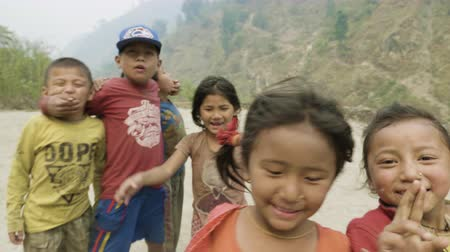 MANASLU, NEPAL - MARCH, 2018: Nepalese children smile and play in the camera.