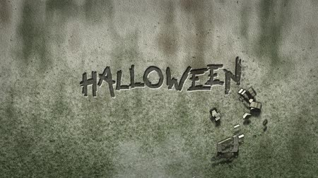 dia das bruxas : the word halloween on stone background