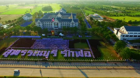 mourners : On 25 November 2016, the people of Suphanburi. Gather for a dedication ceremony of mourning the death of His Majesty the King Bhumibol Adulyadej. People card stunts. Suphanburi love father and 9 Thai