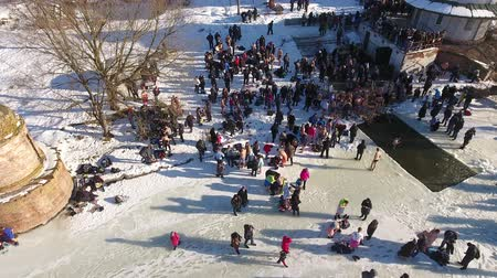 water hole : People bathe in the icy water on the feast of Epiphany Stock Footage