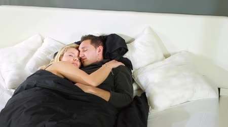 romantic couple : A couple is sleeping in a masterbed and wakes up after a while.