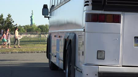 motor vehicle : Bus Parked near Statue of Liberty