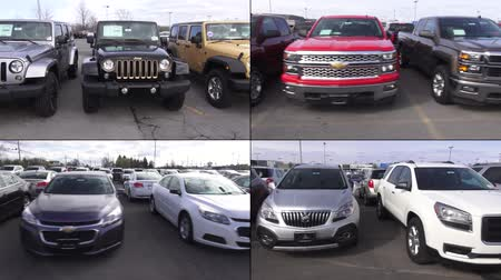используемый : New Cars at Auto Dealership, in Parking Lot