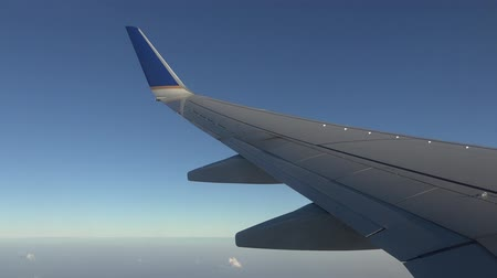 atmosphere : Airplane Wing, Clouds, Flying Jet Aircraft Stock Footage