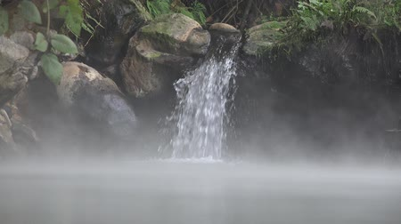 natural tranquil : Water Falling into Natural Thermal Spring